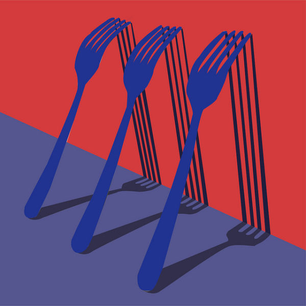 Level 3 Extended Diploma in Art and Design student graphic artwork of blue forks against red wall with shadows