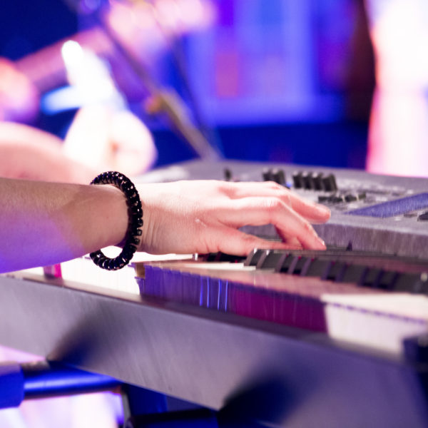 hands at the keyboard during music performance